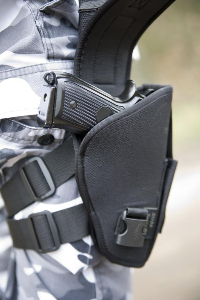 Tactical holster with a gun